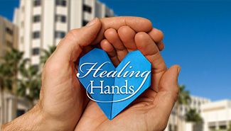 Hands Holding Paper Heart - Loma Linda University Medical Center in Background