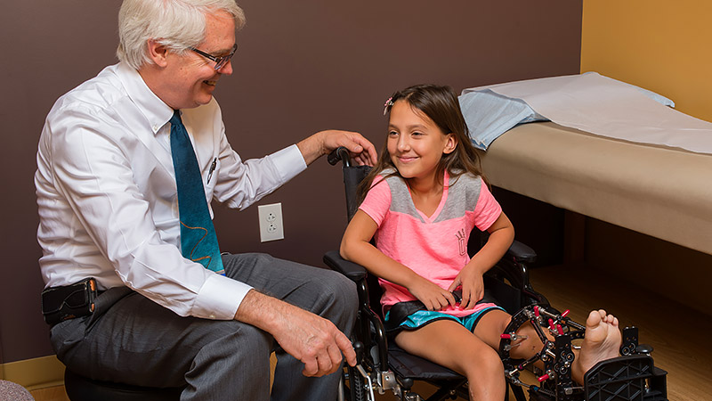 image: Dr. Botimer with an International Limb Lengthening Institute pediatric patient
