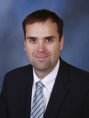 Travis E. Losey, M.D.
