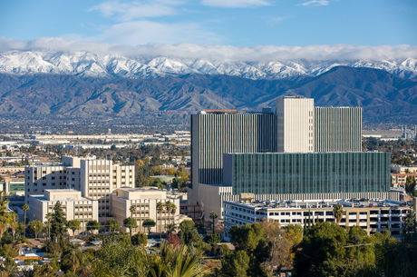 scenic view of hospital and snow-capped mountains in background