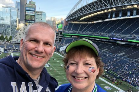From left: Ed Koehn and his wife, Karen, take a selfie in a Seattle stadium to watch their favorite football teams — Cowboys and Seahawks — play in October 2018.