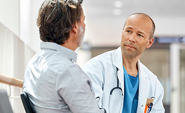 Male patient being examined by a doctor