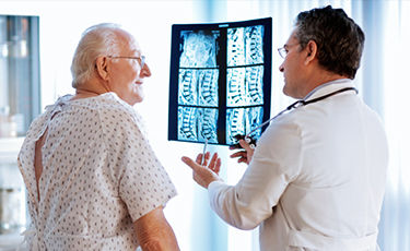 Doctor looking at spine scan