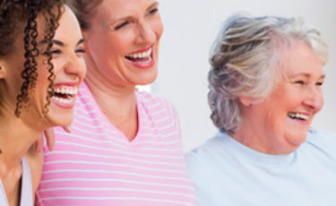 Three happy generational women together smiling