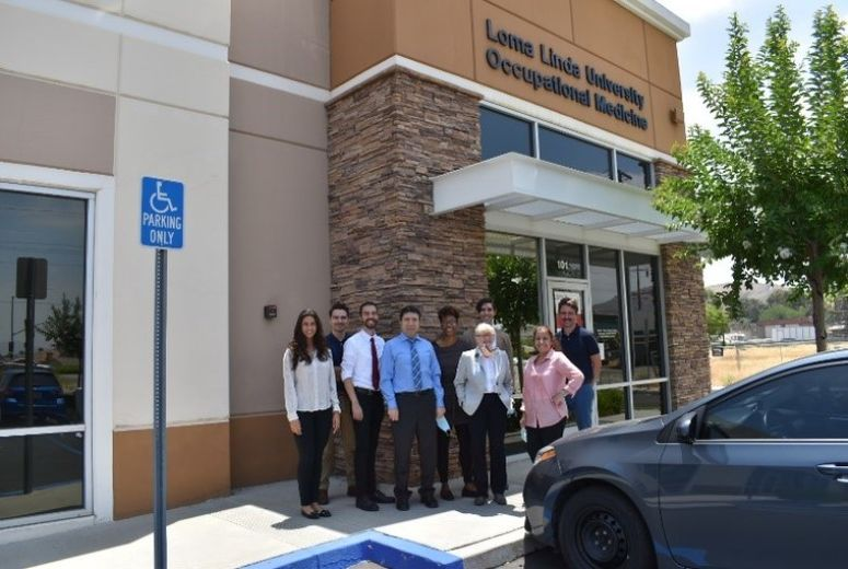 Occupational & Environmental Medicine Residency faculty & residents photo outside OEM office