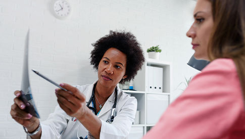 Woman talking with doctor about screening results