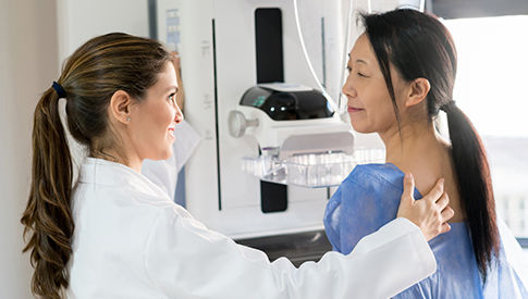 woman getting a mammogram from female doctor