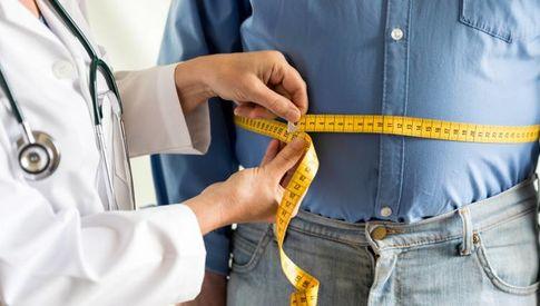 dr measuring mans stomach