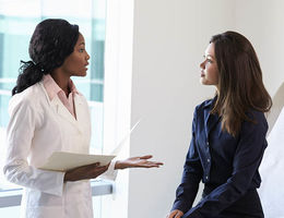 Doctor discussing medical history with patient