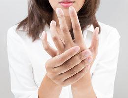 woman rubbing hand