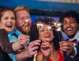 group of four holding 2019 sparklers