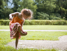 female child looking at her foot
