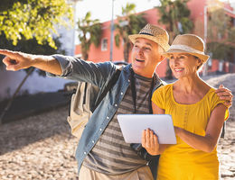 Older couple looking at a map as they navigate their way in a different country