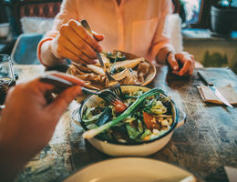 couple eating vegetarian dish