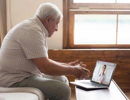 elderly man staring at computer