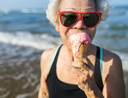 women enjoying ice cream on the beach