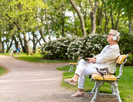 Women sitting on park bench happy and relaxed