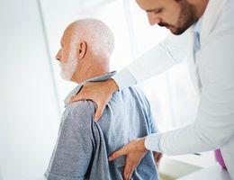 Doctor examining patient's back