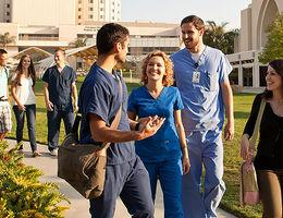 Students walking together outdoors at Loma Linda University Health