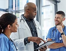 Doctors reviewing patient chart