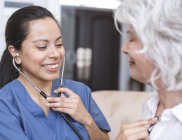 Physician checking patients with a stethoscope