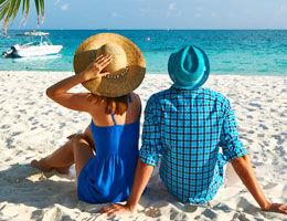 Photo of a couple on a sand beach