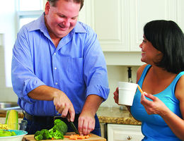 Couple preparing a meal at home